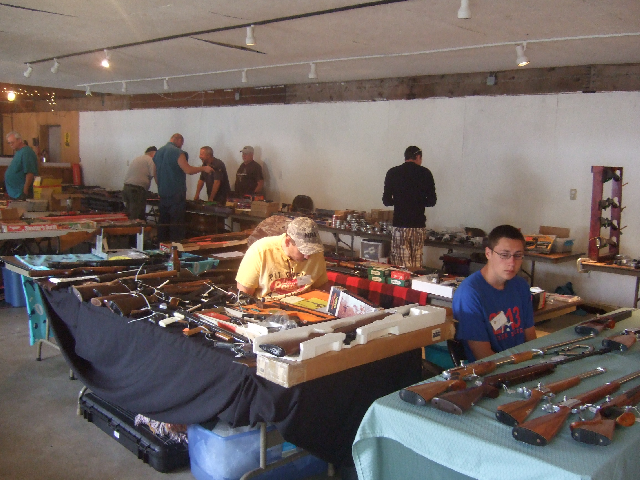 It's early yet. On the right Steve Joseph has some interesting air rifles from the Philippines.